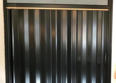 Porta a soffietto in PVC colore nero